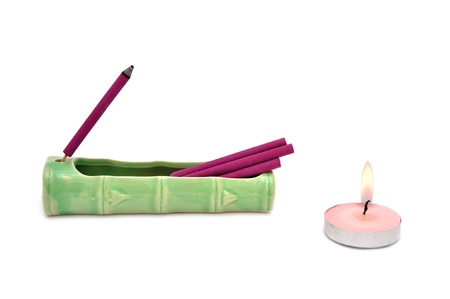 aroma sticks and a candle on a white background photo