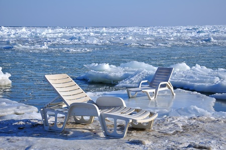 chaise longue on the shore of a frozen sea photo