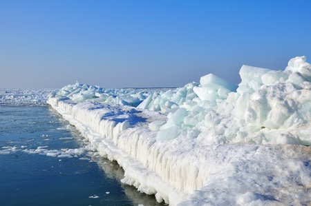 Pierce frozen in ice at sea and blue sky Stock Photo - 12441267