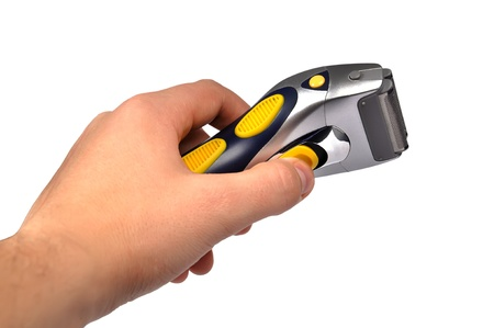 portable electric shaver in hand  on white background photo
