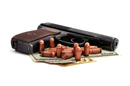 pistol, cartridges and dollars on a white background photo