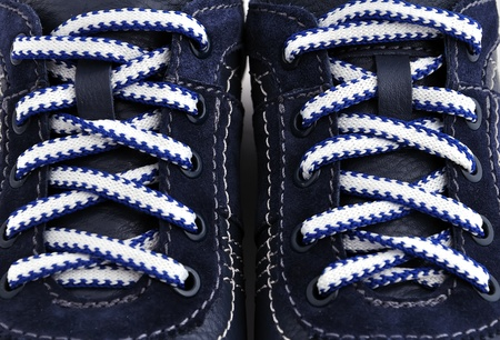strung blue sneakers. close up photo