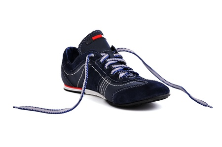 untied: sneakers  with untied laces on a white background