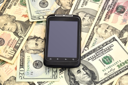 touchscreen mobile phone and dollars on white background photo