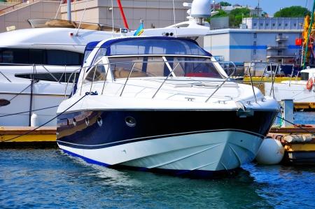 Blue motor yacht in Porto