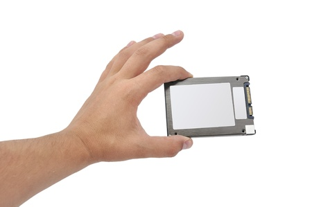 solid-state disk in hand on a white background photo