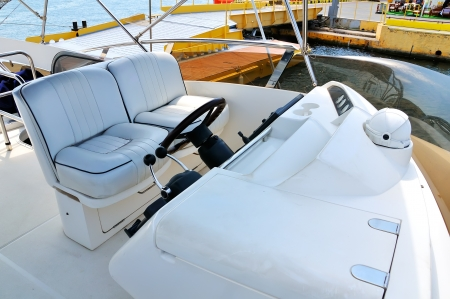 tour boats: steering wheel yacht close up