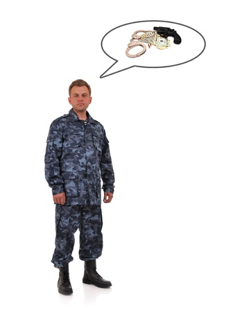man in camouflage clothing thinks of weapons and money photo