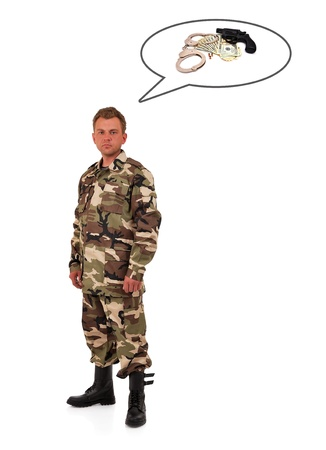man in camouflage  thinks of weapons and money photo