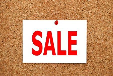 Sale sign attached to a cork board Stock Photo - 15493628