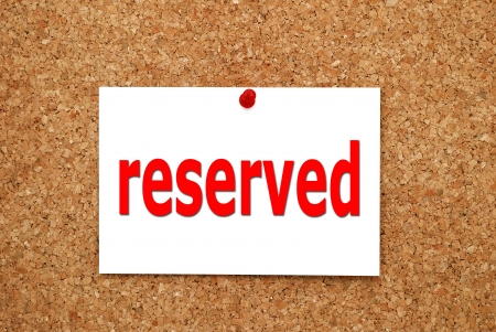 reserved sign attached to a cork board photo