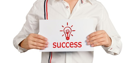 businessman holding a sign saying success Stock Photo - 15400253