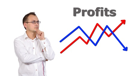 pensive businessman looking at growth chart profit photo