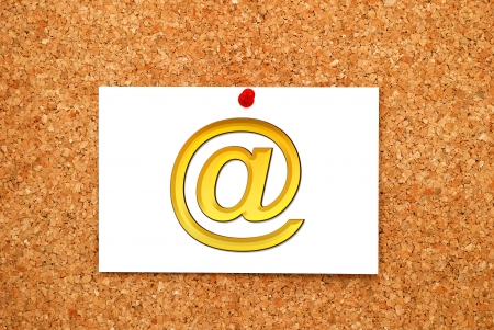Note gold email symbol on cork  board photo