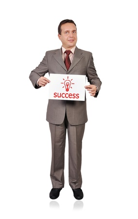 businessman holding a sign saying success Stock Photo - 15977463