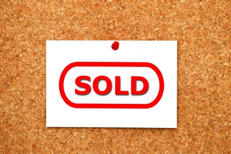 note sold on cork board Stock Photo - 16009305
