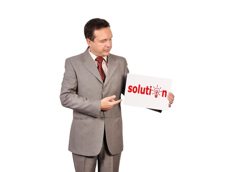 businessman holding a placard with solution Stock Photo - 16057368