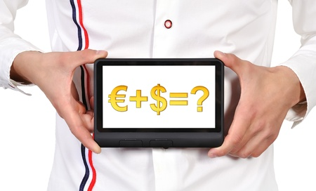 digital tablet in hands and business formula photo