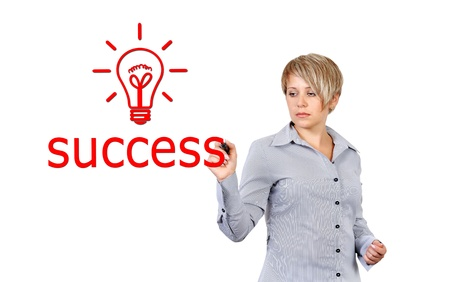 businesswoman writing success symbol photo
