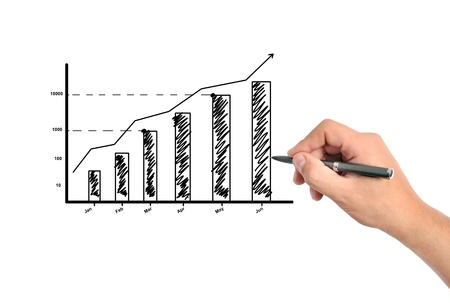 hand draws a graph of business growth photo