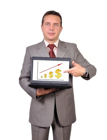 businessman with laptop in hand points to growth dollar photo