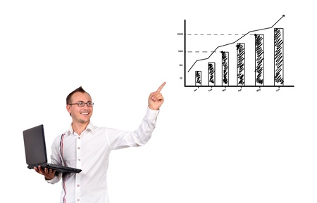 businessman with notebook  points to growth chart photo