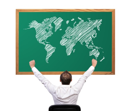 businessman winner and world map on desk photo