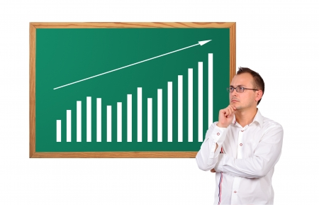 businessman looking at growth chart on desk Stock Photo - 16366461