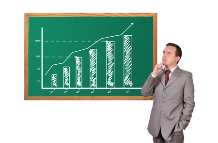 businessman looking at growth chart on desk Stock Photo - 16472583