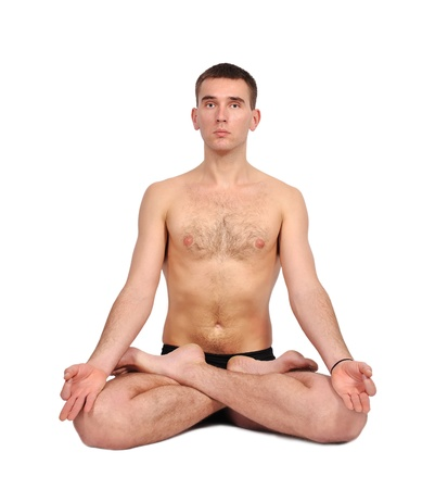 man practicing yoga in the lotus position photo