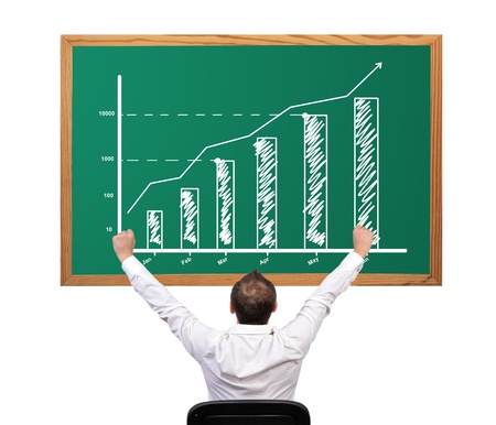 businessman winner and growth chart on desk Stock Photo - 16521184