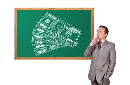 businessman dreaming and hundred dollar bills drawn on blackboard Stock Photo - 16521199
