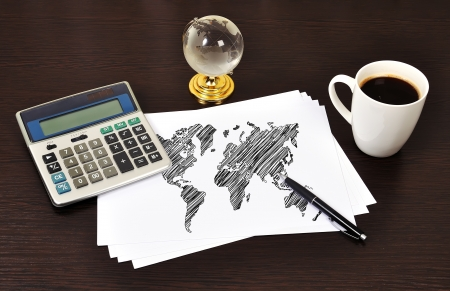 Note map world on table businessman photo