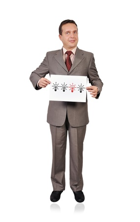businessman holding a placard with lamps. idea concept Stock Photo - 16712497