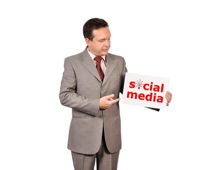 businessman holding a placard with social media Stock Photo - 16712495