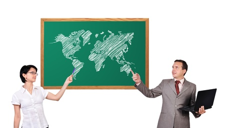 businessman and woman and world map on desk photo