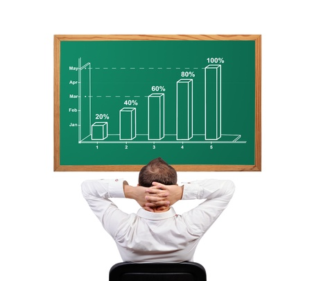 man and growth chart on desk Stock Photo - 16921497