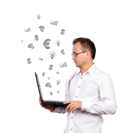 Businessman holding a laptop and business icons  on a white background photo