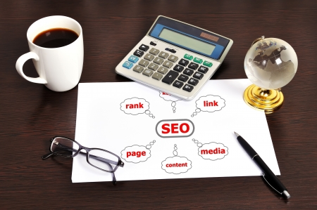 Workplace graph seo on table businessman photo