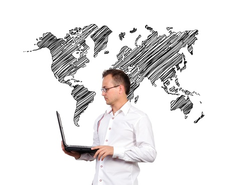 Businessman holding a laptop and world map background photo