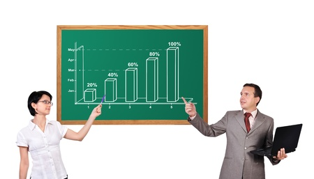 man and woman point to growth chart on desk Stock Photo - 17039055