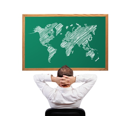 businessman and world map on desk photo