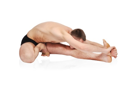 barechested: handsome bare-chested man doing yoga Stock Photo