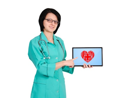 young female doctor with heart symbol on tablet photo