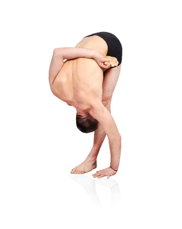 Young man doing yoga exercise  on a white background Stock Photo - 17370689