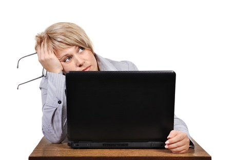 businesswoman with problems before computer in office Imagens