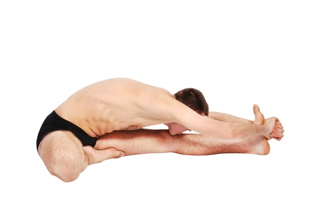 handsome bare-chested man doing yoga photo