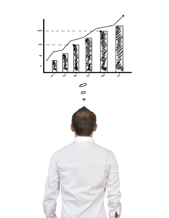 pensive businessman dreaming at chart of profit Stock Photo - 17498708