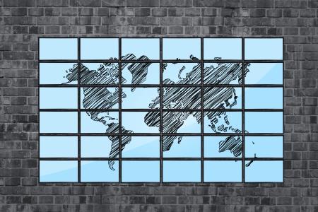 map of world on flat panels on brick wall photo
