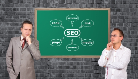 two businessman and scheme seo on desk photo